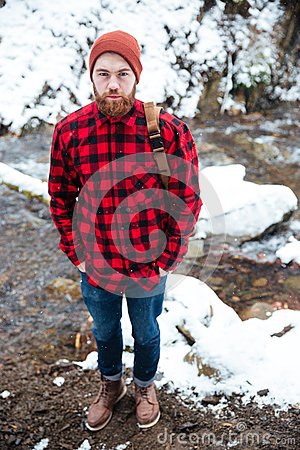 Free Man With Backpack Standing In Winter Forest Near Mountain River Royalty Free Stock Photos - 68977738