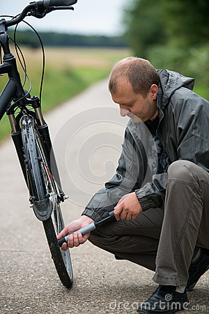 Free Man With Bicycle Royalty Free Stock Photo - 26362275
