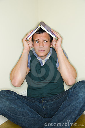 Free Man With Book On His Head Royalty Free Stock Photography - 5621787