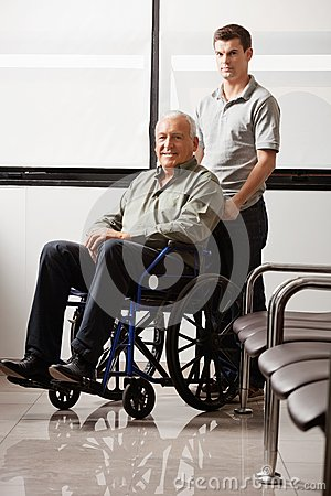 Free Man With Grandfather Sitting In Wheelchair Royalty Free Stock Image - 36290406