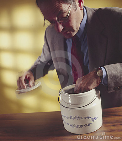 Free Man With Hand In Cookie Jar_1 Royalty Free Stock Images - 5942909