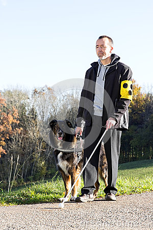 Free Man With His Guide Dog Royalty Free Stock Photography - 49186957