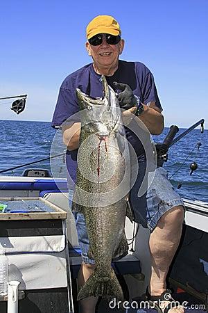 Free Man With Large Fish - Lake Ontario King Salmon Royalty Free Stock Photo - 18644925