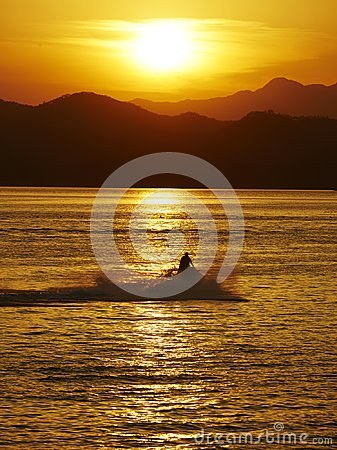 Free Man With Moto-boat In Sunset Royalty Free Stock Images - 104807539