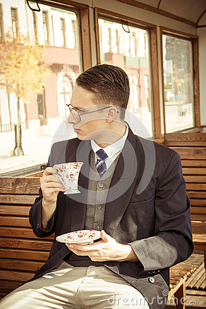 Free Man With Mustache And Glasses On Train Wooden Wagon Drinking Cof Stock Photos - 46632323