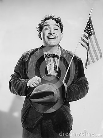 Free Man With The American Flag In His Hand Smiling Stock Image - 52029931