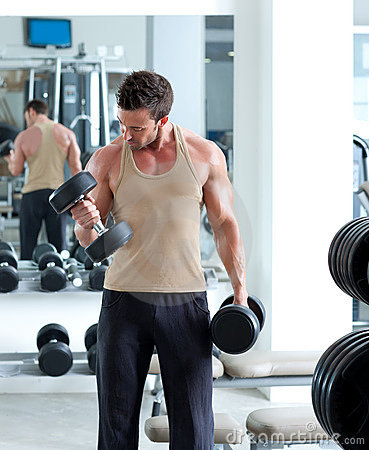 Free Man With Weight Training Equipment On Sport Gym Royalty Free Stock Images - 22840299