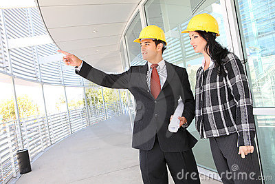 Man and Woman Architects on Construction Site