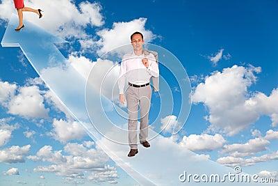 Man and woman on arrow on sky