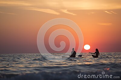 Man And Woman Boat Rowing In Sea During Golden Hour Free Public Domain Cc0 Image