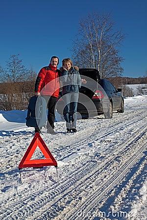 Man And Woman Broken Down car