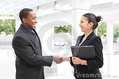 Man and Woman Business Team Handshake