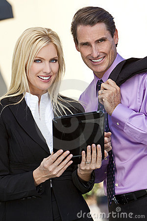 Man & Woman BusinessTeam Using Tablet Computer