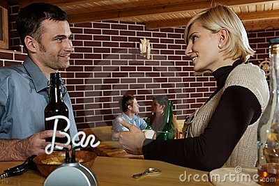 Man and woman chatting in bar