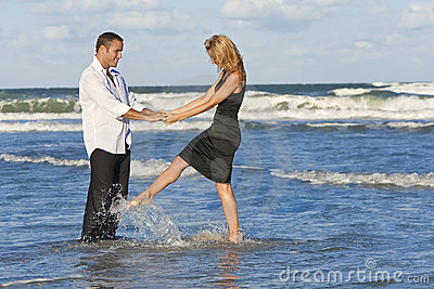 Man and Woman Couple Having Fun Dancing On A Beach