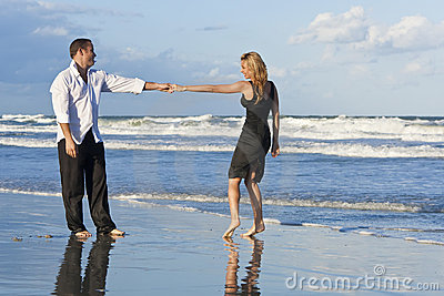 Man and Woman Couple Having Fun Dancing On A Beach