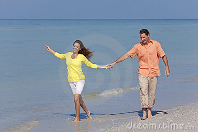 Man & Woman Couple Holding Hands on a Beach