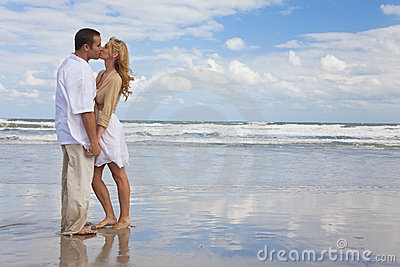 Man & Woman Couple Holding Hands Kissing On Beach