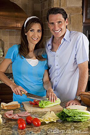 Man & Woman Couple In Kitchen With Salad