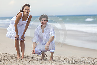 Man & Woman Couple Together on a Beach