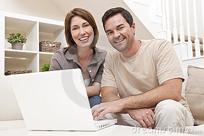 Man Woman Couple Using Laptop Computer At Home