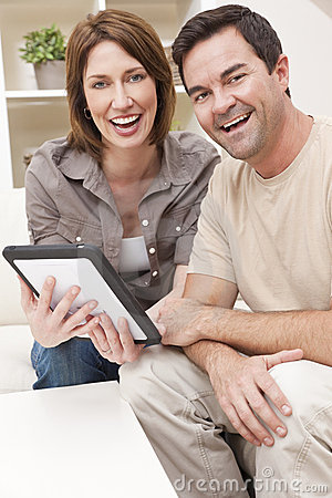 Man & Woman Couple Using Tablet Computer at Home