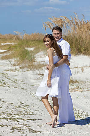 Man and Woman Couple Walking on An Empty Beach