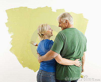 Man and woman discussing paint job.