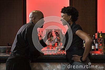 Man and Woman Drinking at Bar