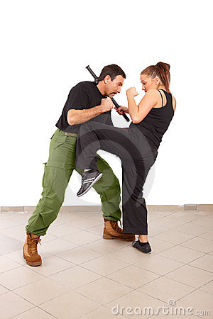 Man and woman fight with truncheon