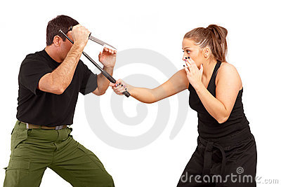 Man and woman fight using knife and truncheon