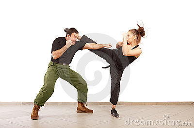 Man and woman fighting together