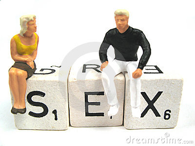 Man and woman figurines on the spelled word sex