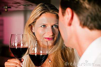 Man and woman flirting in hotel bar