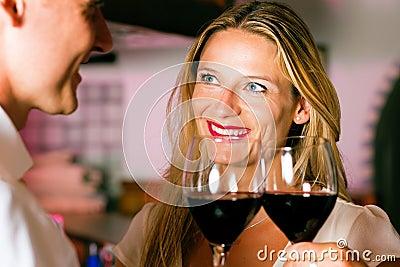 Man and woman flirting in hotel bar