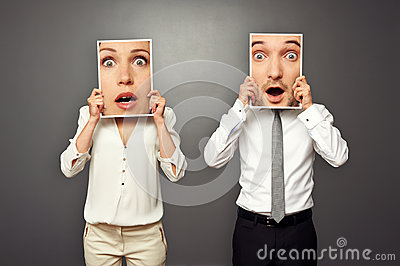 Man and woman with frames amazed faces