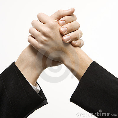 Man and woman grasping hands.
