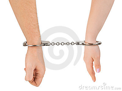 Man and woman hands and handcuffs