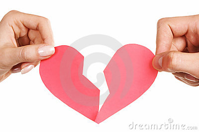 Man woman hands holding broken heart