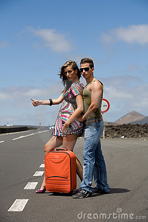 Man and woman hitchhiking