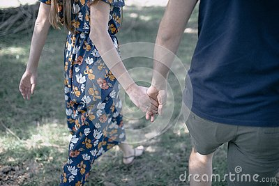 Man and woman hold hands close up Stock Photo