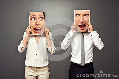 Man and woman holding amazed shouting faces