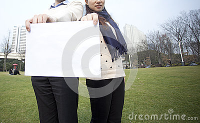 Man and women holding blank paper