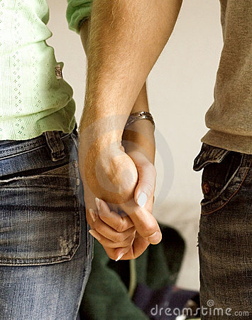Man and woman holding hands.