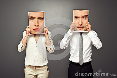 Man and woman holding photos