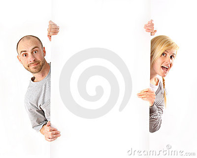Man and woman holding white board
