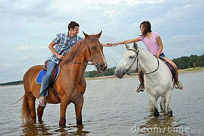 Man and a woman on horseback