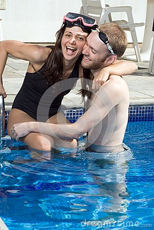 Man and woman hugging in a pool vertical stock image for Pool man show