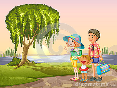 Man, woman and kid standing around tree