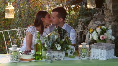 Man and woman kissing at the holiday table stock footage